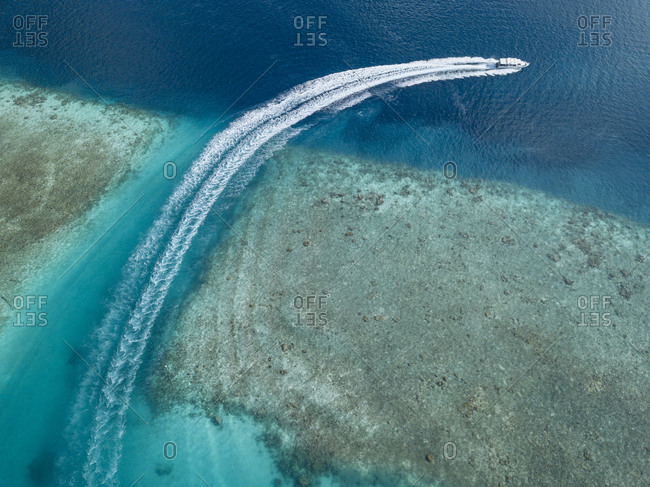 Aerial view of boat on sea at Maldives during sunny day
