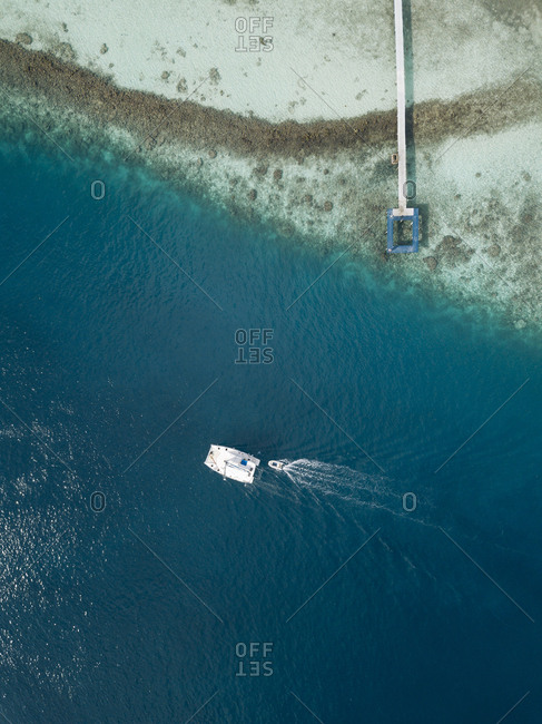 Aerial view of boat on sea sunny day
