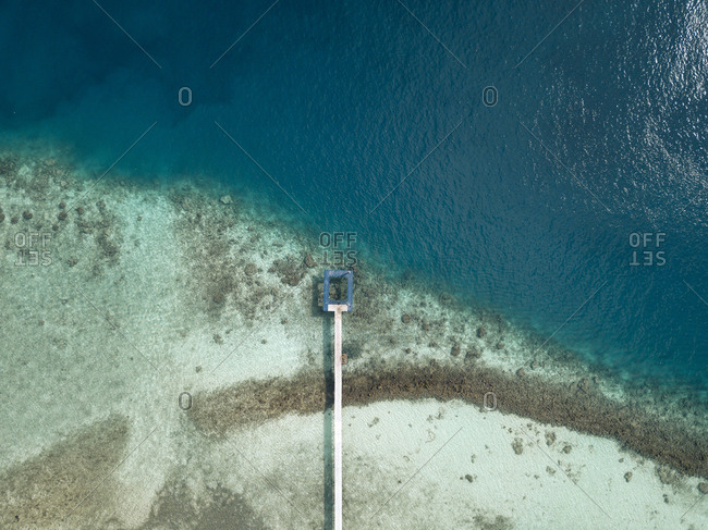 Aerial view of pier over sea at Maldives