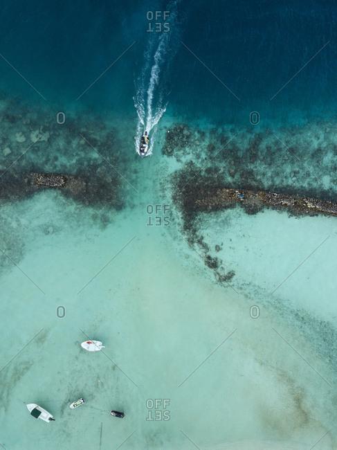 Aerial view of boats on sea at Maldives