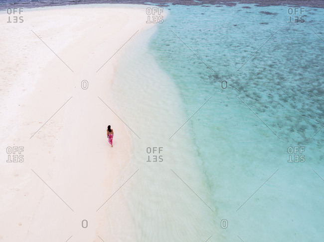 Aerial view of woman walking at beach