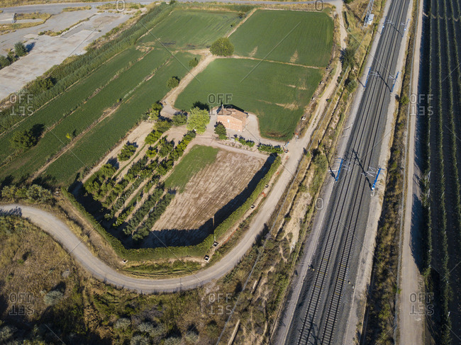 Aerial view of industrial infrastructure of railways, roads and agricultural fields in the autonomous community of Catalonia Spain