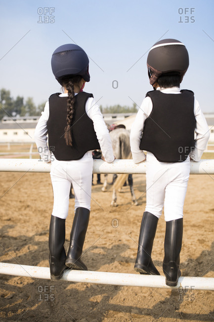 Little Chinese children taking part in equestrian club
