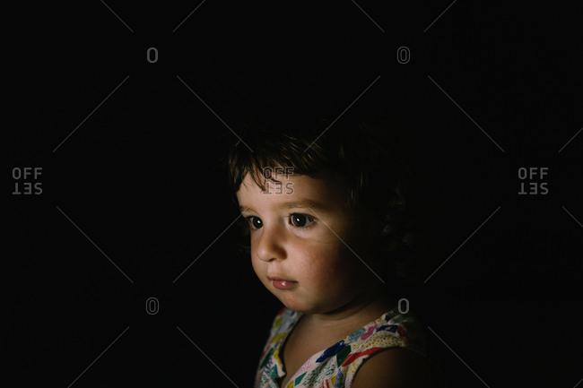 Baby girl portrait in the dark