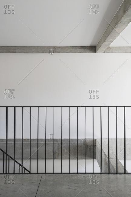 Metal railing on interior stairwell