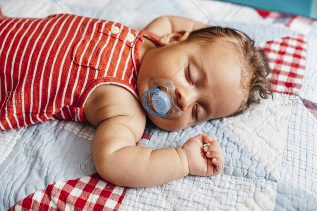 Sleeping baby on a quilt