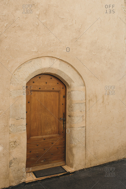 Arched wooden door on building in France