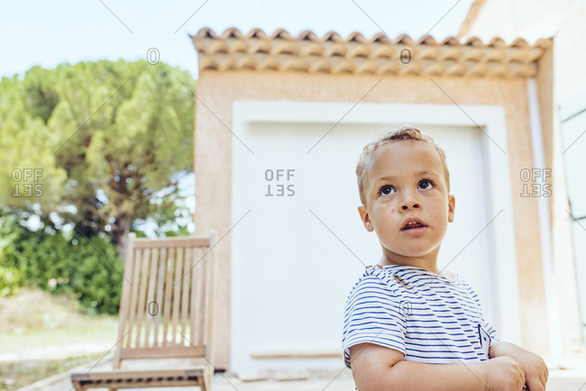 Biracial toddler boy playing outside