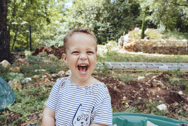 Smiling toddler boy playing outside