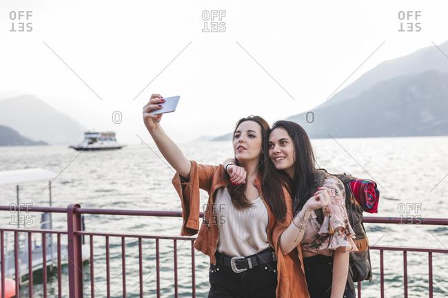 Women take a selfie on pier