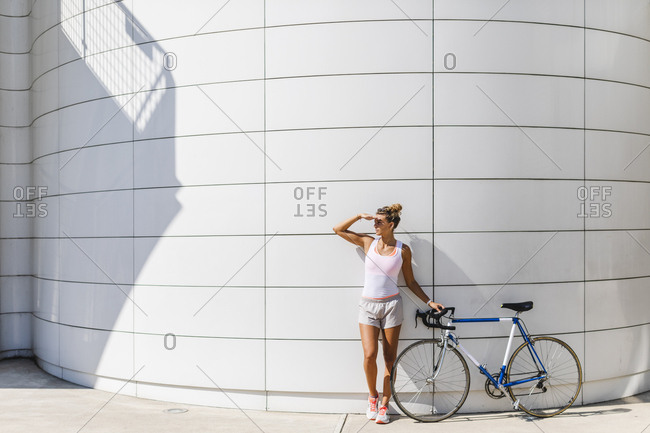 Woman with road bicycle in the city