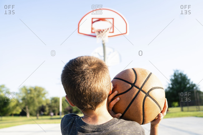 Boy preparing to throw a basketball on the court