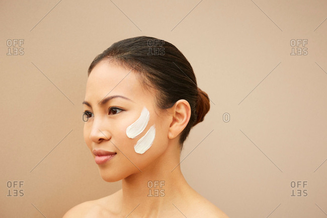 Woman with white marks on cheek