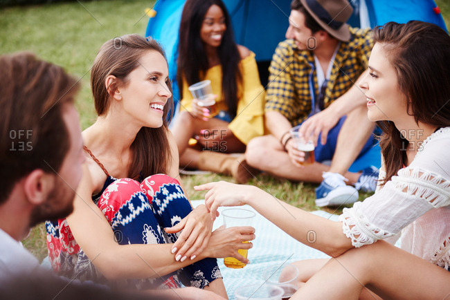 Friends sitting and enjoying music festival