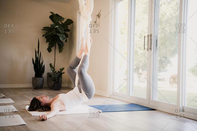 Women doing aerial yoga at retreat