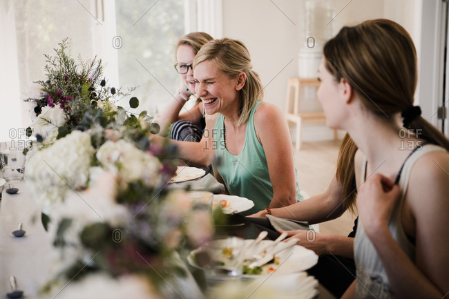 Women enjoying friendship and meal in yoga retreat