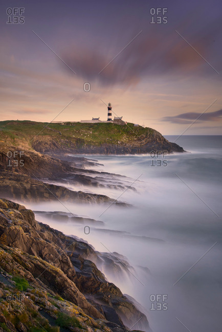 Scenic view of Old Head of Kinsale with lighthouse at sunset, Kinsale, Cork, Ireland