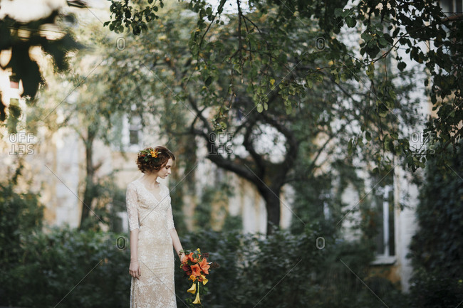 Bride with orange and yellow lily bouquet