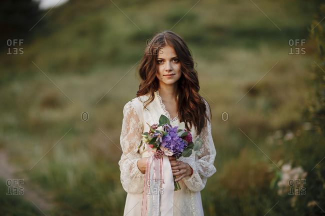 Brunette bride with bouquet