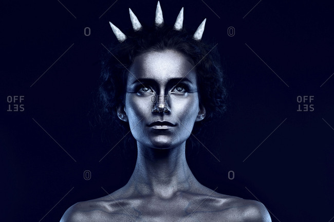 Portrait of girl with crown in blue light