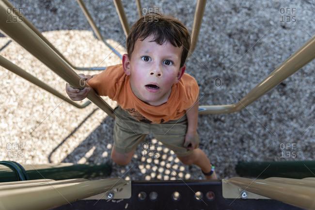 Overhead view of boy on playground equipment