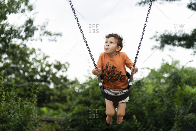 Young boy on swing at park