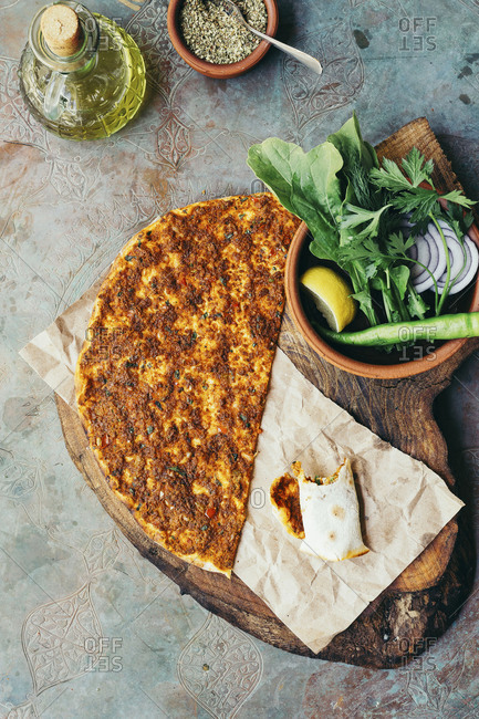 Local food Lahmacun served on a metal surface