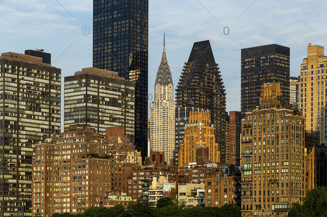 The Chrysler building and Midtown Manhattan buildings viewed from Roosevelt Island in the early morning