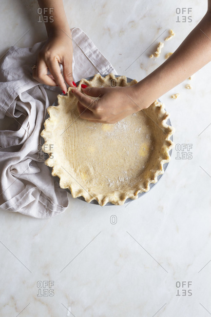 Woman crimping pie crust