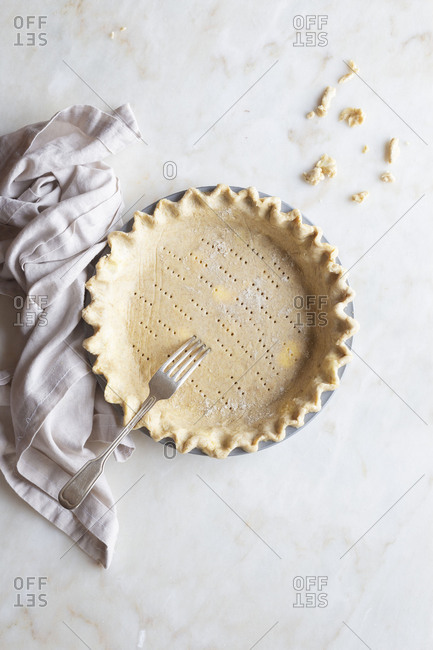 Pie crust with poked holes and crimped edge
