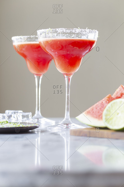 Two freshly made watermelon margaritas served in glasses with salted rims