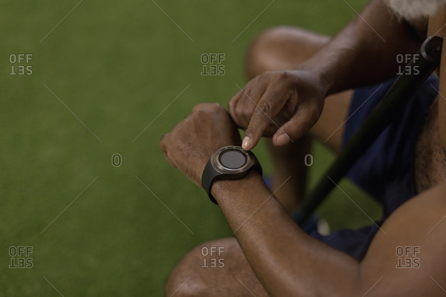 Close-up of man checking his smart watch