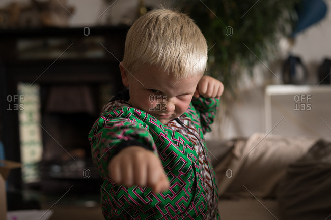 Boy performing martial arts in living room art home