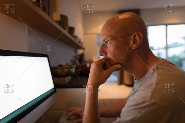 Man working on personal computer at home