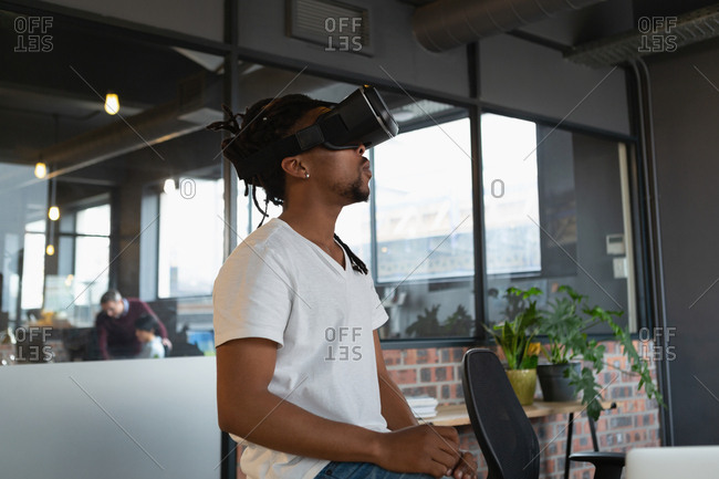 Man experiencing virtual reality headset in the office