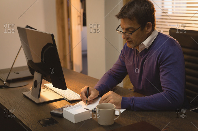 Businessman working on his desk at office