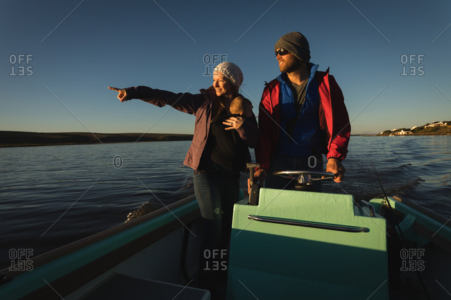 Family riding motorboat on river