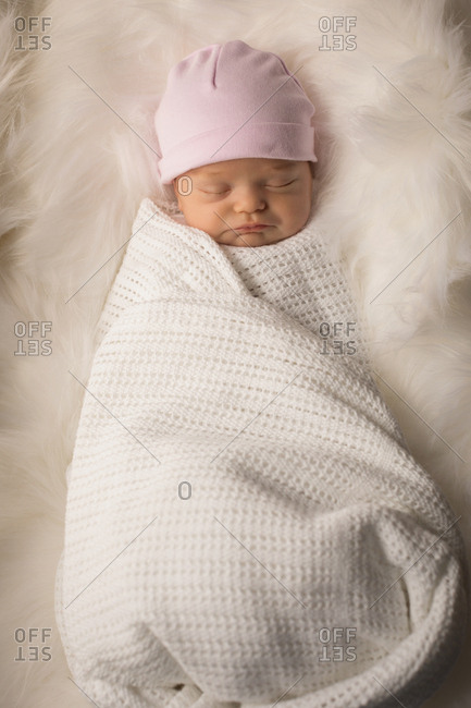 Newborn baby sleeping on baby bed at home