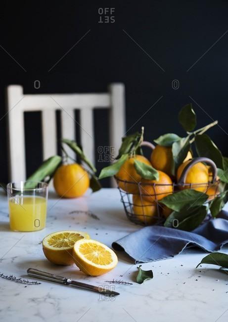 Orange juice and fresh oranges on the table