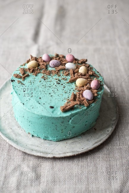 Easter cake with mini eggs and chocolate shavings