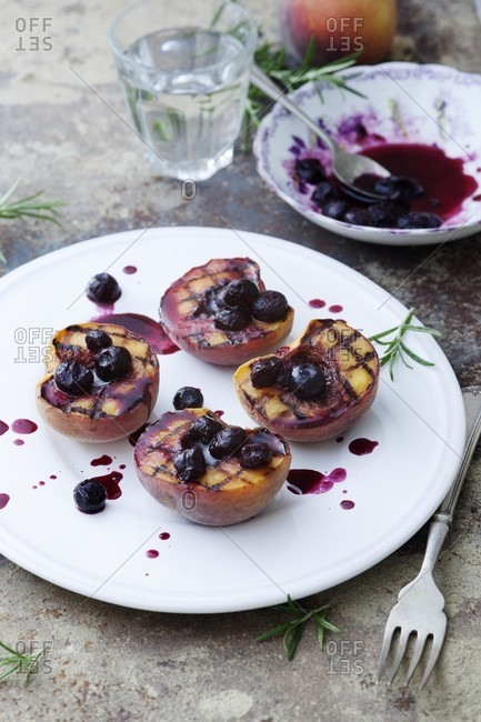 Griddled peaches with a blueberry sauce