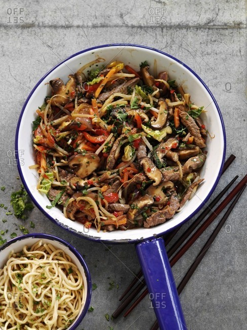 Quick and easy beef stir fry with vegetables served with a side dish of noodles