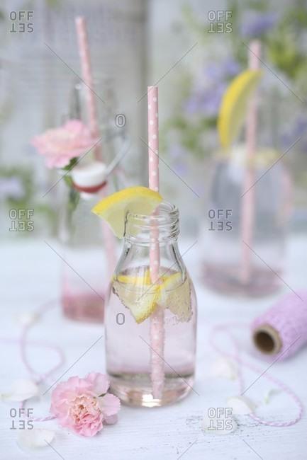 Pink lemonade in bottles