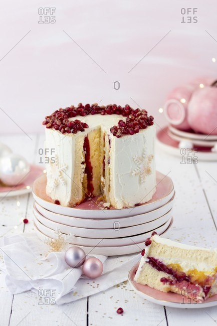 A rolled cake with cranberries and cream for Christmas