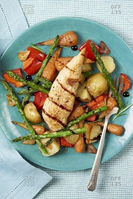 Grilled chicken breast on roasted vegetables