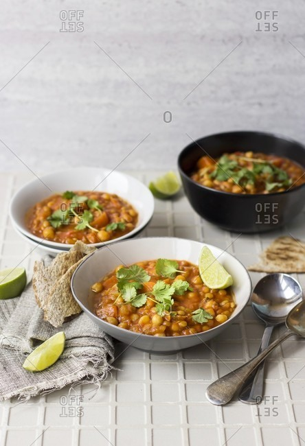Harira soup with lime wedges and coriander