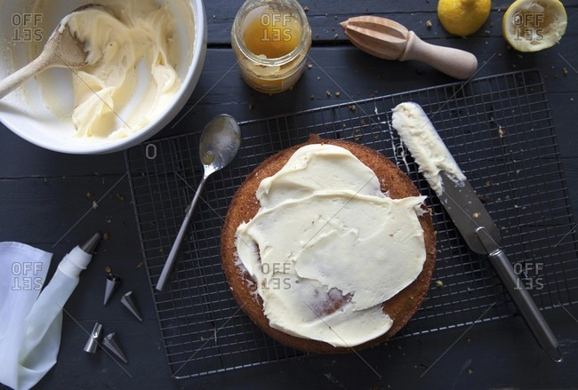 Sponge cake being decorated with icing