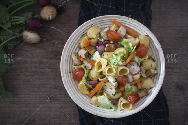 Pasta salad with pointed cabbage, tomatoes, smoked tofu, and radishes (vegan)