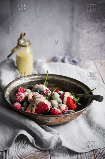 Frozen berries with a creme anglaise sauce, dairy free