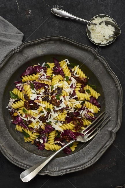 Fusilli with radicchio, dried tomatoes, raisins, pine nuts and saffron